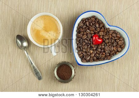 Roasted coffee beans on the kitchen table. Fresh coffee. Preparation of hot coffee. Refreshing drink. Sales of coffee beans. Advertising for coffee shop. We love fresh coffee.