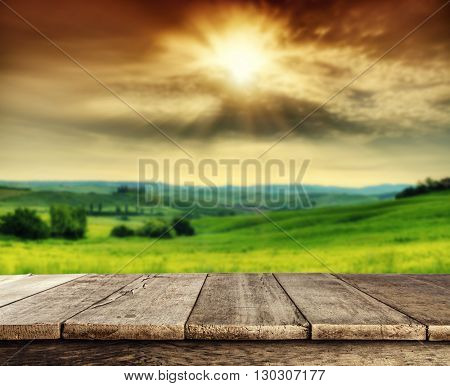Empty wooden planks with Italian landscape on background. Ideal for product placement