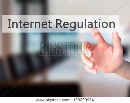 Internet Regulation - Hand Pressing A Button On Blurred Background Concept On Visual Screen.