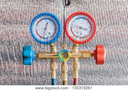 Pressure gauges for auto air conditioner recharge.