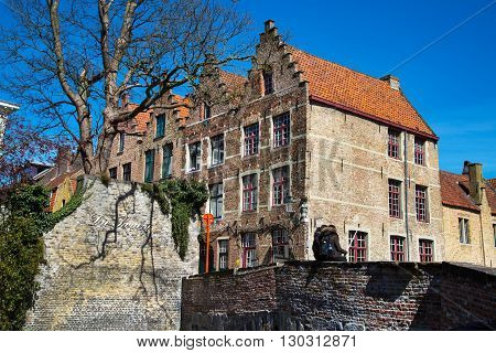 Bruges, Belgium - April 10 ,2016: Scenic cityscape with houses, bridge and couple making selfie in Bruges, Belgium