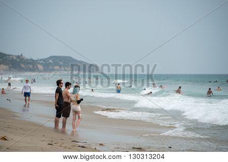Los Angeles, Usa - August 3, 2014 - People On Zuma Sandy  Beach