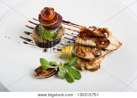 Grilled white fish fillet with grilled vegetables