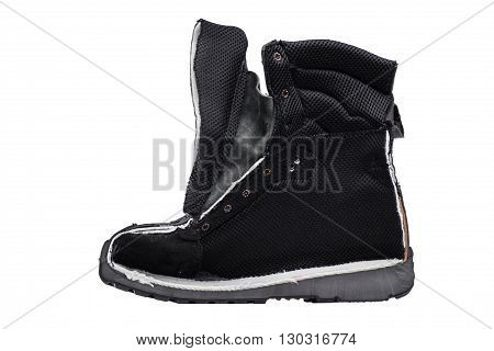 Black boot sawn in half isolated on white background