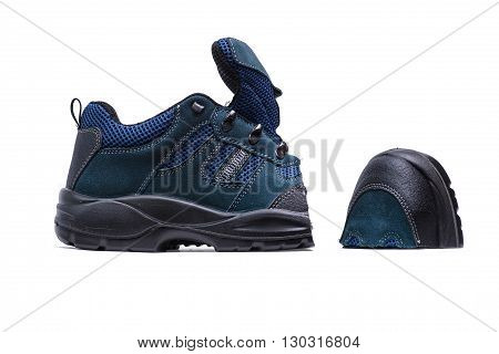 New blue sneakers for running cut in half nose shoe lying near on white background