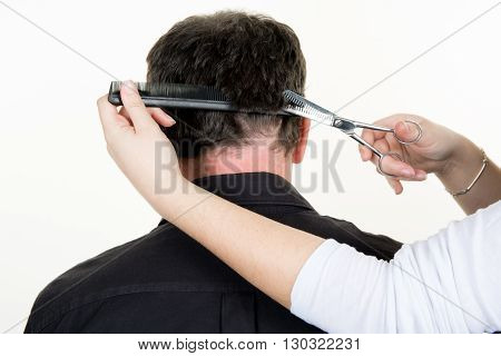 Hairdresser Cutting Hair Of Man Client At Beauty Parlour