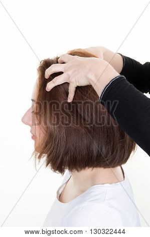 Woman getting a massage while having hair cut at salon by hairdresser