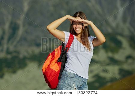 photo of young beautiful girl climbing the rock