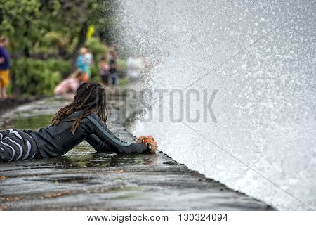 Rasta Man Photographing Sea Wave