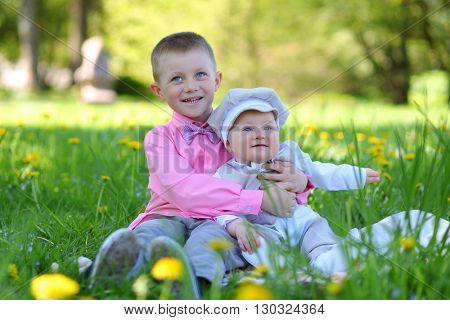 happy brothers walking in park