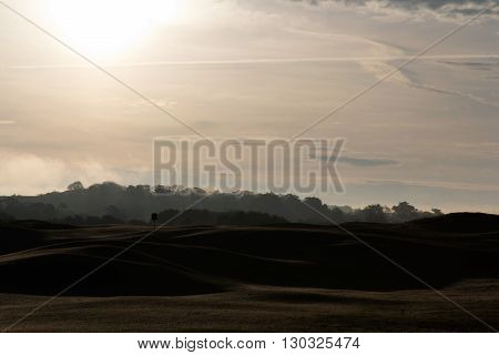 Golf course at dawn with low light