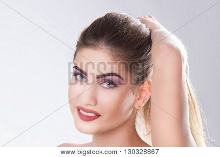 close up - a face of the young beautiful woman. horizontal portrait on a white background
