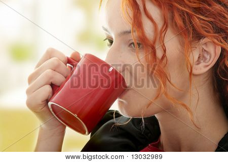 Beautiful deaf woman drinking coffee