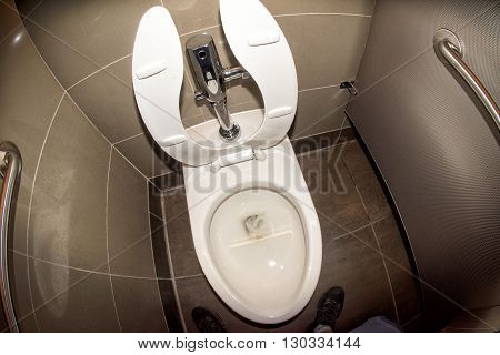 dirty urinating in public toilet wc close up