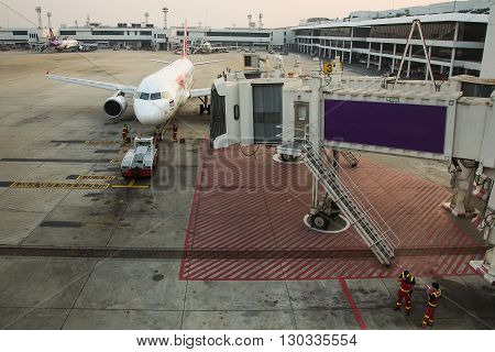 Don Mueang Airport, Thailand - MARCH 2, 2016 : Thai Air Asia airplane come to parking at passenger tube for loading passenger at Don Mueang Airport in Bangkok,Thailand