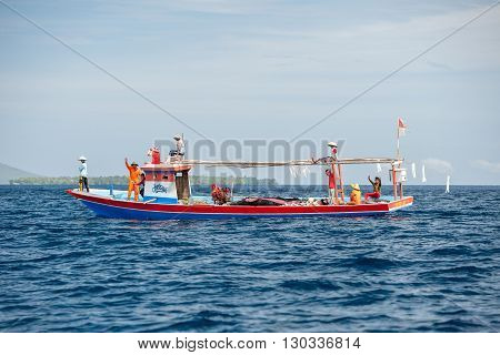 Bunaken, Indonesia - April, 5 2014 - Fishing Boat Returning To Fisherman Village