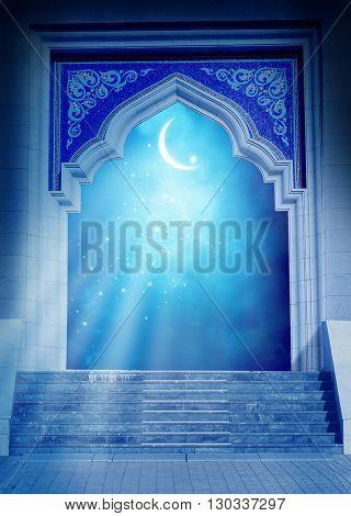 Ramadan Kareem background.Mosque door with shiny crescent moon