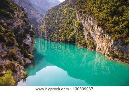 Spring Provence. The biggest mountain canyon in Europe - Verdon. Smooth-blue water reflecting the clouds