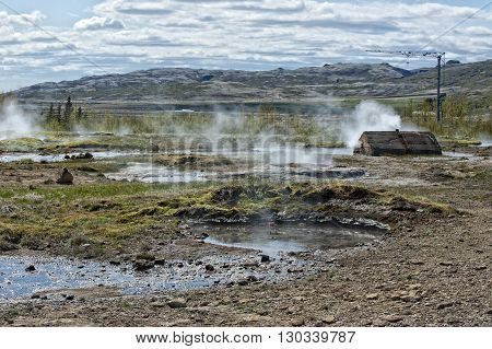 Little Geyser In Iceland While Blowing Water