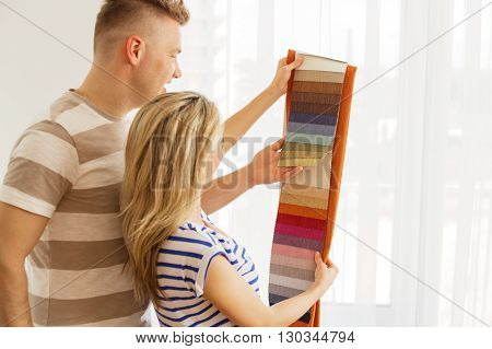 Couple choosing color for their new apartment
