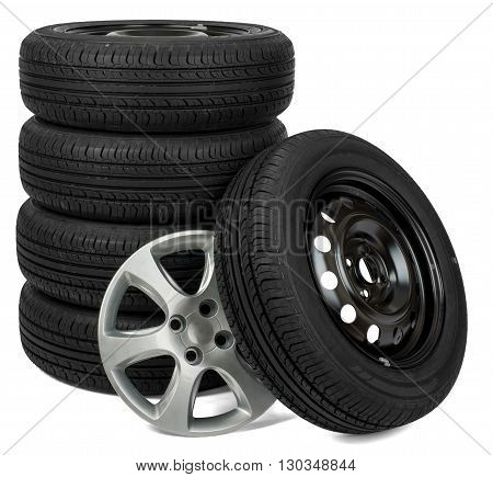 Closeup of five tires with wheel cap, isolated over white background