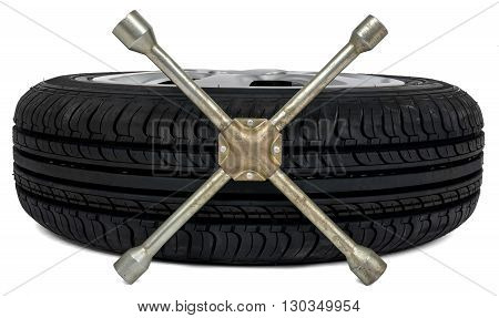 Car tyre with screwdriver on white background