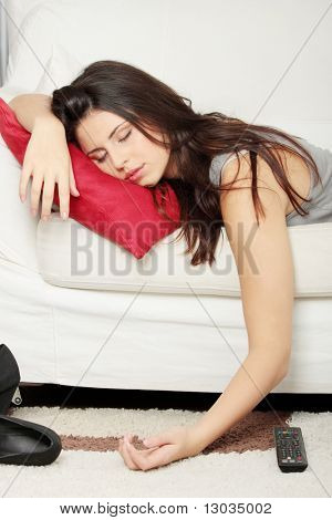 Beautiful young woman sleeping on sofa.