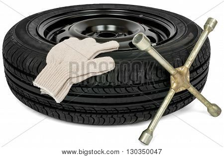 Car service. Tyre with screwdriver and white glove. Isolated
