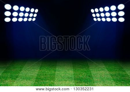 Two spotlights on football grass field. Empty place for text or product