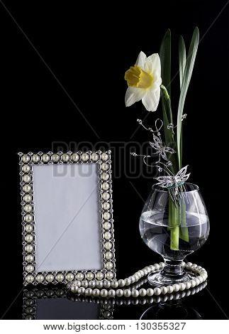 floral composition frame glass lilia black background