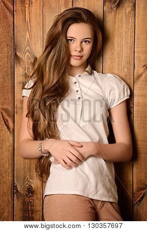 Cute girl with beautiful healthy long hair smiling at camera. Healthy hair, haircare.