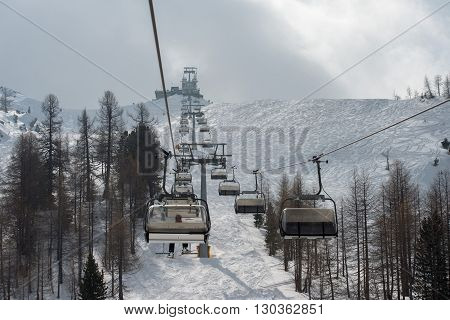 Chair Lift For Skiers In Winter Snow