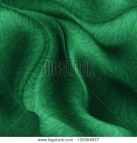 Seamless patterned green fabric with a floral pattern in the form of vines