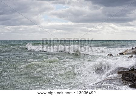 Sea In Tempest On Rocks Of Italian Village