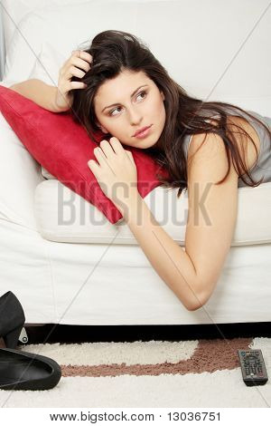 Beautiful young woman sleeping on sofa at her home.