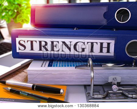 Blue Ring Binder with Inscription Strength on Background of Working Table with Office Supplies and Laptop. Strength - Toned Illustration. Strength Business Concept on Blurred Background. 3D Render.