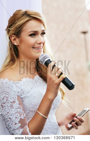 Beautiful blonde bride taking vows at wedding ceremony