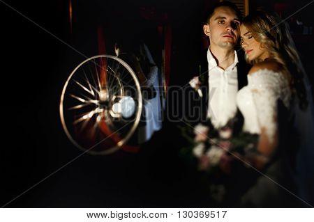Romantic Newlyweds Posing In Dark Rustic Red Restaurant Room