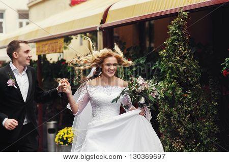 Romantic Newlyweds Walking Down Old European Street