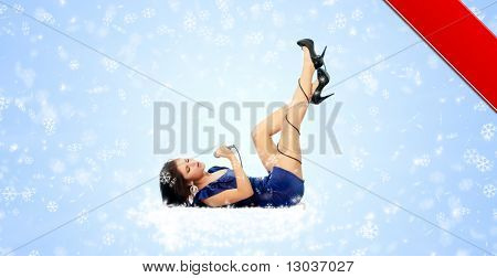 Beautiful young singer on abstract winter background (post card design)