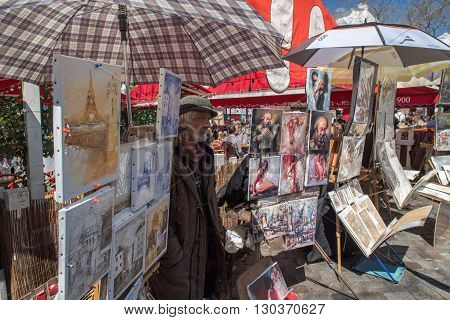 Paris, France - May 1 2016 - Artist And Tourist In Montmartre