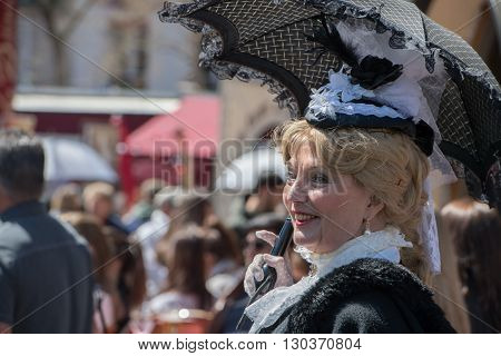 Paris, France - May 1 2016 - Old Dressed Woman In Montmartre Crowded Of People For Sunday Sunny Day