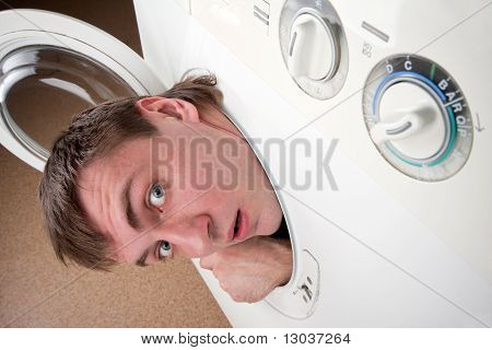 Surprised Man Inside Washing Machine