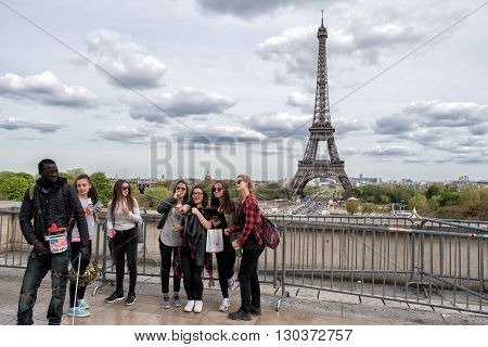 Paris, France - May 2, 2016: Tourist Taking Pictures At Tour Eiffel Town Symbol