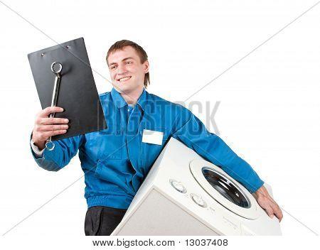 Repairman Servicing Washing Machine