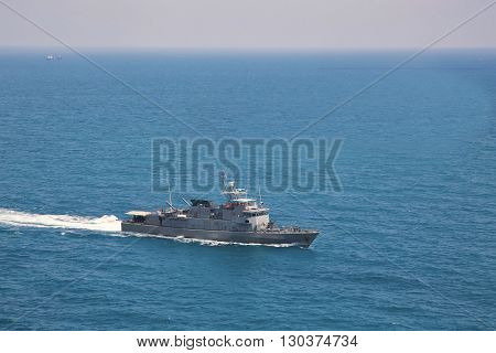 Modern military navy ships in a sea bay