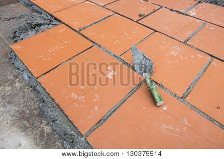 Home improvement, renovation construction trowel with cement mortar for tiles work, tile floor adhesive