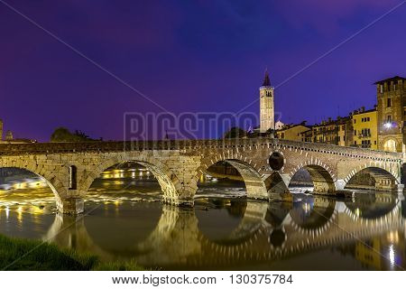 Verona, Italy - June 21, 2015: night photo of Stone Bridge on the River Adige . The only remains of the Roman bridge . entire city of Verona is the site unesco