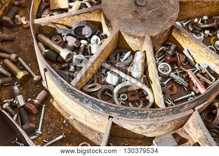 Rusty tools in an old wooden toolbox