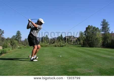 Golfer About To Drive Golf Ball Off Of Tee